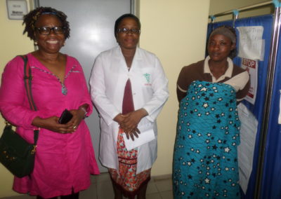 LCHCF Secretary Dr. Mrs Odeka Presenting the PTAP grant to the beneficiary's parent