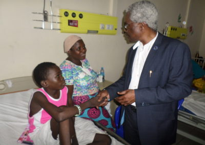 LCHCF CEO Dr. Benjamin Odeka shaking hands with PTAP grant Beneficiary