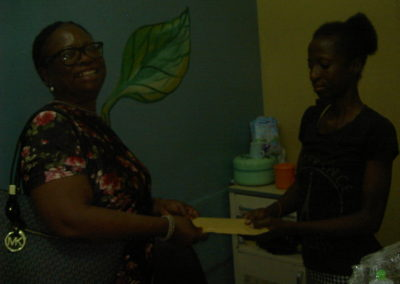 LHCHF Secretary Dr. Mrs. Odeka donating the P-TAP token to Angel Ojimmado's Mother Paediatric unit at Maitama District Hospital Abuja