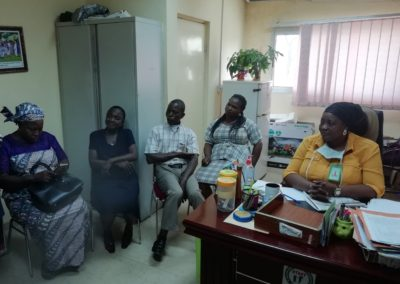 The Secretary Asokoro Hospital hosting the participant in her office