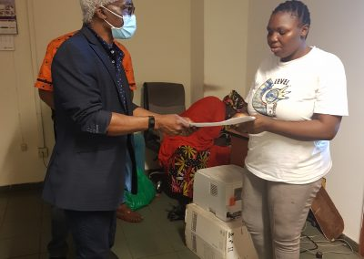 Presentation of PTAP Medical Grant to the Mother of a Beneficiary at the National Hospital