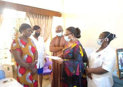 The Operational Director and Secretary to LHCHF presents PTAP Grant to Buba David, 8 year old Blood Cancer Patient at University of Abuja Teaching Hospital, Gwagwal