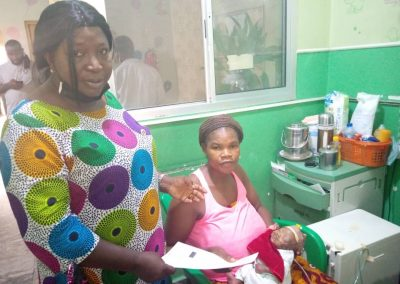 Mrs Ekama, LHCHF PTAP Committee Member presenting PTAP Medical Grant to the Mother of St. John Ogbe at Asokoro District Hospital