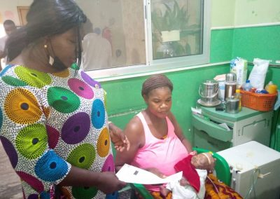 Presentation of PTAP Medical Grant to the Mother of St. John Ogbe 2 month old Congenital Heart Disease Patient at Asokoro District Hospital